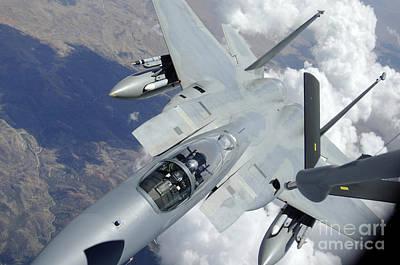 An F-15 Eagle Pulls Away From A Kc-135 Art Print by Stocktrek Images