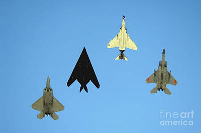 Photograph - An F-22 Raptor, An F-117 Nighthawk, An by Stocktrek Images