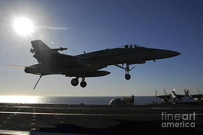 Jolly Old Saint Nick - An Fa-18 Hornet Prepares To Make An by Stocktrek Images