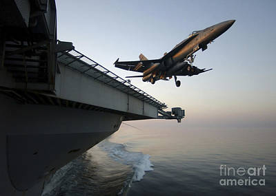 Caravaggio - An Fa-18a Hornet Clears The Flight Deck by Stocktrek Images