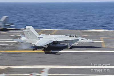 An Fa-18c Hornet Lands Aboard Uss Art Print by Stocktrek Images