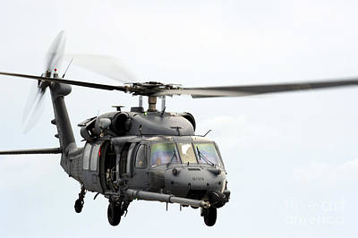 An Hh-60 Pave Hawk Helicopter Conducts Art Print