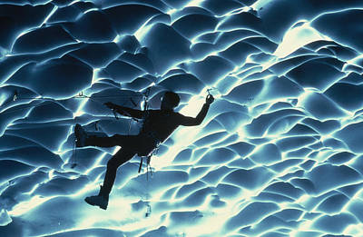 An Ice Climber Crosses The Ceiling Print by Carsten Peter