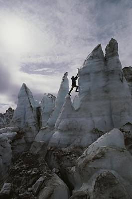 An Ice Climber Scales A Pinnacle Art Print by George F. Mobley