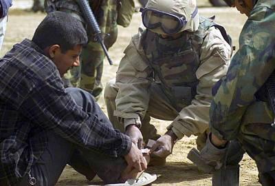 An Iraqi Detainee Receives A Band-aid Art Print