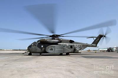 An Mh-53e Sea Dragon Helicopter Sits Art Print