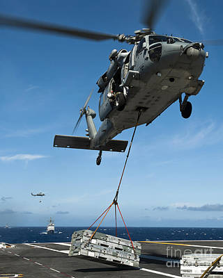 An Mh-60s Sea Hawk Helicopter Lowers Art Print by Stocktrek Images