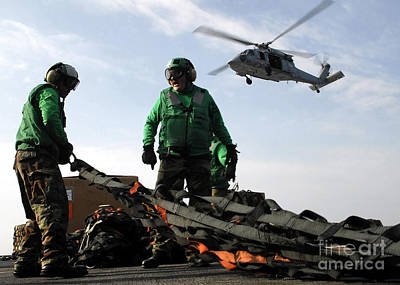 City Scenes - An Mh-60s Seahawk Passes Over Two by Stocktrek Images