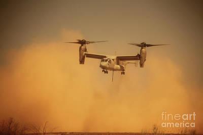 An Mv-22 Osprey Aircraft Blows Dust Art Print by Stocktrek Images