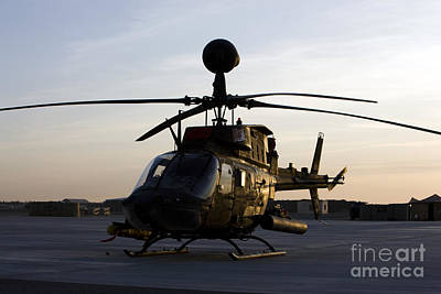 Photograph - An Oh-58d Kiowa During Sunset by Terry Moore