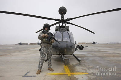 An Oh-58d Kiowa Warrior Pilot Stands Print by Terry Moore