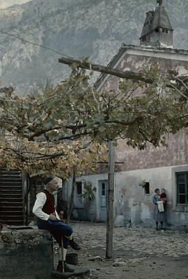 Yugoslavian Photograph - An Old Man Sitting Under His Grape by Wilhelm Tobien