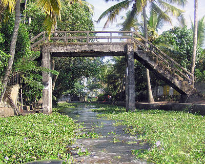 An Old Stone Bridge Over A Canal In Alleppey Art Print