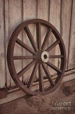 An Old Wagon Wheel Art Print by Donna Greene