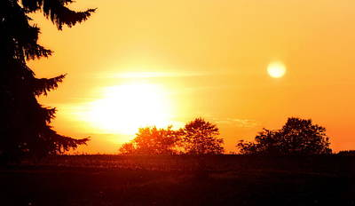 Photograph - Photograph Of The White Hot Sun On An Orange Horizon With Lens Flare by Angela Rath