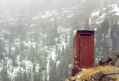 An Outhouse Perches On A Hillside Art Print by Rex A. Stucky