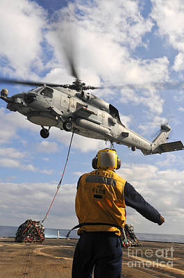 An Sh-60b Sea Hawk Helicopter Releases Art Print by Stocktrek Images