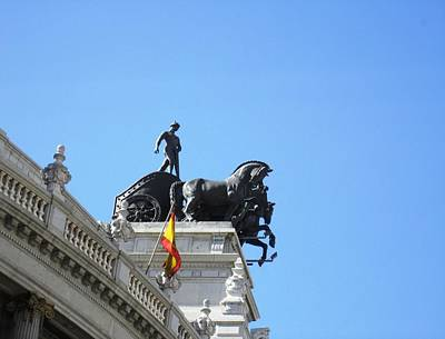 Photograph - Ancient Horse And Buggy Statue And Spanish Flag In Madrid Spain by John Shiron