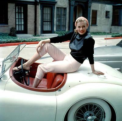 1950s Portraits Photograph - Anita Ekberg, On Her Jaguar, Late 1950s by Everett