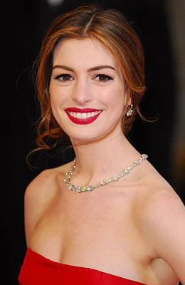 The 83rd Academy Awards Oscars - Arrivals Part 1 Photograph - Anne Hathaway Wearing Tiffany Jewelry by Everett