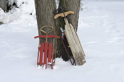 Antique Sleds In The Snow On A  Family Art Print