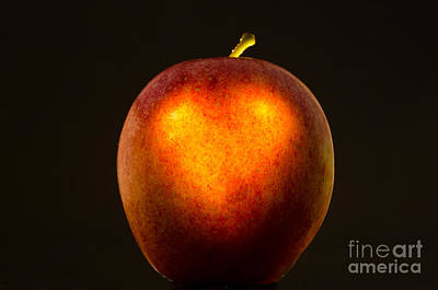 Apple With A Illuminated Heart Art Print by Mats Silvan