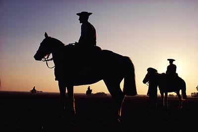 Four Horsemen Photograph - Argentina, Horsemen In Landscape, Silhouette, Sunset by Christopher Pillitz