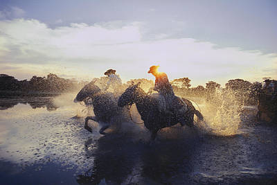 Working Cowboy Photograph - Argentine Gauchos Race Across A Lake by O. Louis Mazzatenta
