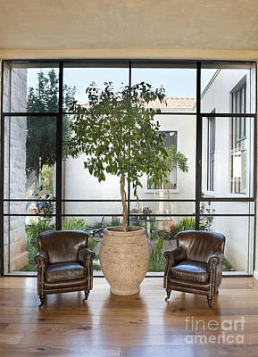 Armchairs In Front Of A Large Window Art Print by Noam Armonn