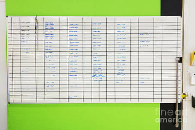 Wall Chart Photograph - Assignment Board On Green Wall by Don Mason