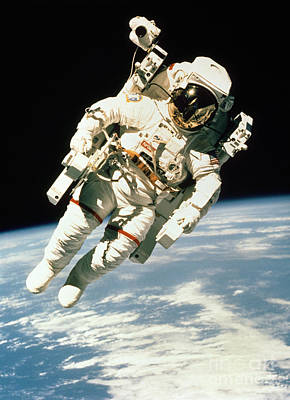Astronomy Photograph - Astronaut In Space by NASA / Science Source