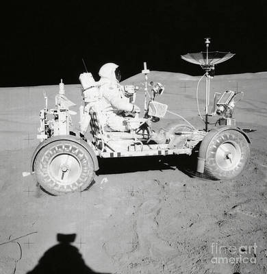 Photograph - Astronaut Is Seated In The Lunar Roving by Stocktrek Images
