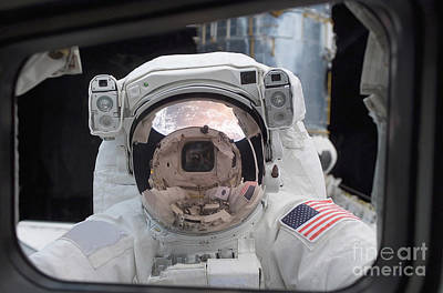 Photograph - Astronaut Peers Into The Crew Cabin by Stocktrek Images
