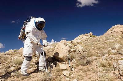 Photograph - Astronaut Stands Beside A Core Sampling by Stocktrek Images