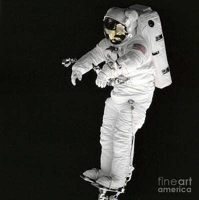 Astronaut Stands On A Portable Foot Art Print by Stocktrek Images