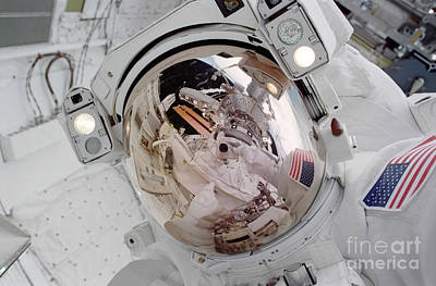 Photograph - Astronaut Uses A 35mm Camera To Expose by Stocktrek Images