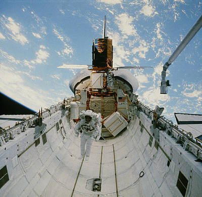 Solar Maximum Mission Photograph - Astronaut Van Hoften In Shuttle Cargo Bay, 41-c by Nasa.