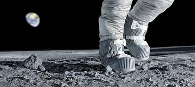 Astronaut Walking On The Moon Art Print by Detlev Van Ravenswaay