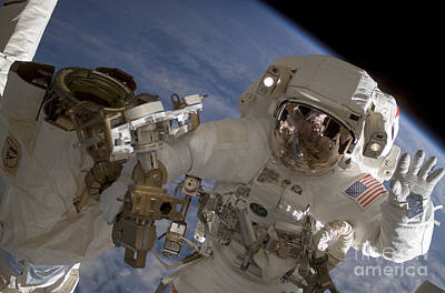 Photograph - Astronaut Waves To The Camera While by Stocktrek Images