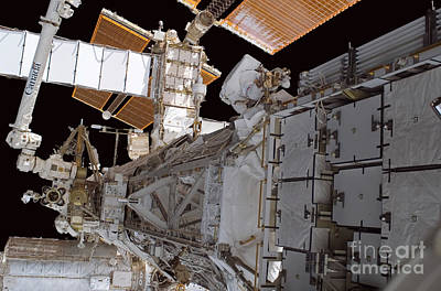 Photograph - Astronaut Works Near The Solar Alpha by Stocktrek Images