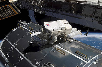 Photograph - Astronaut Works On The New Columbus by Stocktrek Images