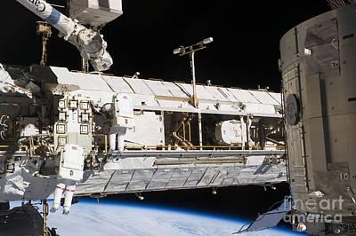 Photograph - Astronauts Continue Maintenance by Stocktrek Images