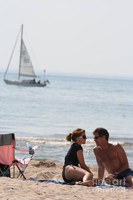 Sailboat Photograph - Attractive Couple Sitting On Beach by Christopher Purcell