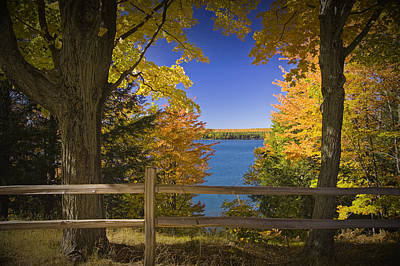 Thomas Kinkade Royalty Free Images - Autumn Trees with fence near Frankfort Michigan Royalty-Free Image by Randall Nyhof