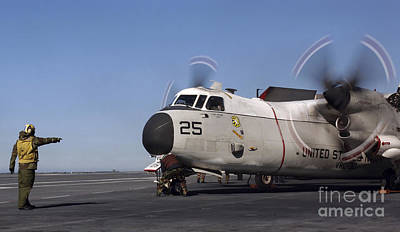 Greyhound Photograph - Aviation Boatswain Mate Directs A C-2a by Stocktrek Images