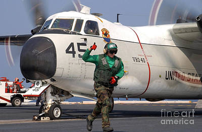 Greyhound Photograph - Aviation Boatswains Mate Gives by Stocktrek Images