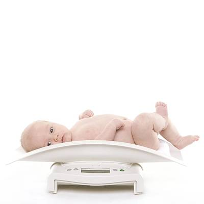 Nappy Photograph - Baby Being Weighed by