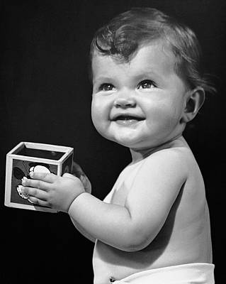 Baby Holding Block Art Print by George Marks