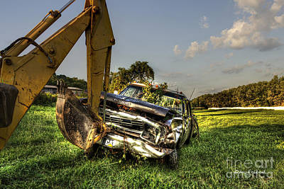 Backhoe Pulling Car Out Of Field Art Print by Dan Friend
