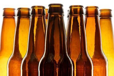 Row Of Bottles Photograph - Backlit Beer Bottles by Dennis J. Wilkinson, II